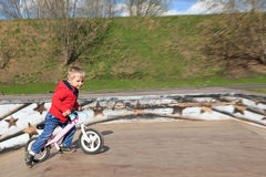 Little boy riding runbike Stock Photography
