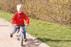 Little boy riding runbike Stock Photo