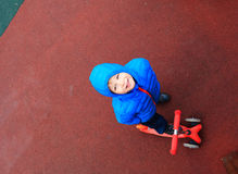 Little boy riding scooter, high angle view Royalty Free Stock Photography