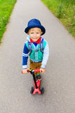 Little boy riding scooter to school, high angle Stock Photos