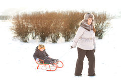 Little boy riding on a sled Stock Image