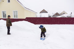A little boy riding on a snowy hill Royalty Free Stock Photography