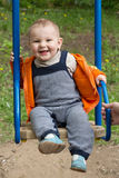 Little boy riding on a swing Royalty Free Stock Photos