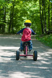 Little boy riding a tricycle Royalty Free Stock Photos