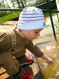 Little boy by the river. Danger, little baby boy walk alone to the river Royalty Free Stock Photos