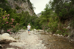 Little boy by the river Stock Images