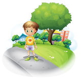 A little boy at the road across the high buildings Stock Photography