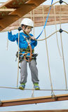 Little boy on the roap course sky trail Royalty Free Stock Image