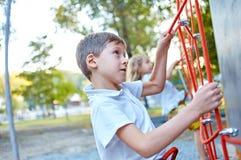 Little boy in  rock climbing gym Stock Photo