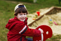 Little boy on rocking horse Royalty Free Stock Photography