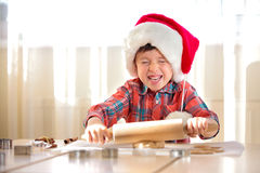 Little boy with rolling pins baking and having fun Stock Images