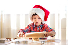 Little boy with rolling pins baking and having fun Royalty Free Stock Photography