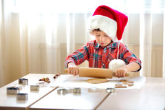 Little boy with rolling pins baking and having fun Stock Image