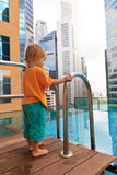 Little boy in roof top pool Stock Images