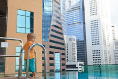 Little boy playing in roof top pool Royalty Free Stock Image