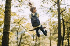 Little boy on a Rope Swing. Little boy is having a go on a rope swing he has found while hiking Stock Images