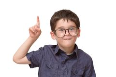 Little boy in round spectacles raising finger. In funny attention gesture isolated Royalty Free Stock Photography