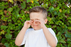 Little boy rubbing eyes for allergy Royalty Free Stock Photos