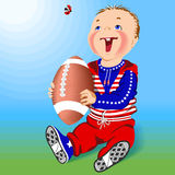 Little boy and rugby ball. Stock Image