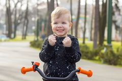Little boy on the run bike Royalty Free Stock Images