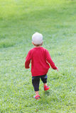 Little boy run on the grass law Stock Image