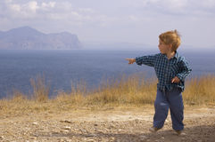 Little boy run and show sea Royalty Free Stock Images