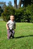 Little boy running Stock Images