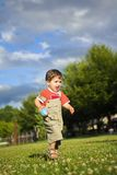Little boy running Stock Image