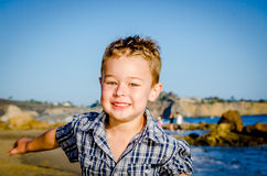 Little Boy running at the beach Stock Images