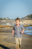 Little Boy running at the beach Royalty Free Stock Photography