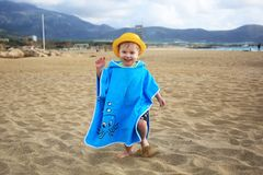 Little boy running on the beach of Crete Royalty Free Stock Images