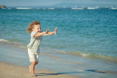Little boy running on the beach Royalty Free Stock Photo