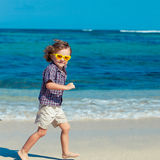 Little boy running on the beach Royalty Free Stock Images