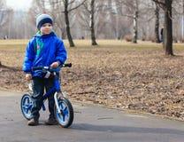 Little boy on running bike in autumn Royalty Free Stock Photos