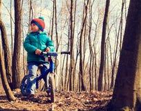 Little boy on running bike outdoors, kids sport Royalty Free Stock Photos