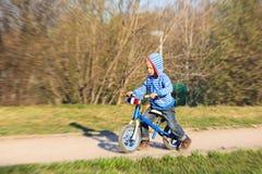 Little boy on running bike outdoors, kids sport Stock Images