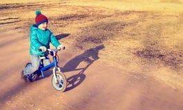Little boy on running bike outdoors, kids sport Stock Photography