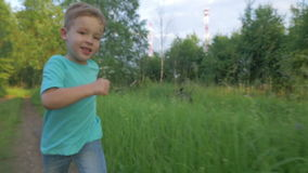 Little Boy Running on Country Road stock video
