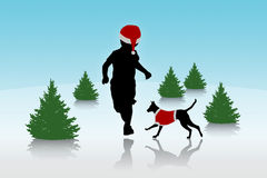 Little boy running with a dog on christmas background Stock Image