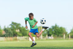 Little boy running dribbling. On the sports field Stock Images