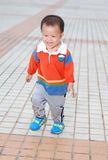 Little boy running on the ground Royalty Free Stock Photos