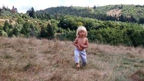 Little boy running on a hay field stock video