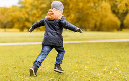 Little boy running outdoors Royalty Free Stock Photos