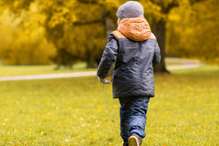 Little boy running outdoors Royalty Free Stock Photo