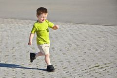 Little boy running Royalty Free Stock Photos