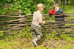 Little boy running over to greet his friend Stock Photos