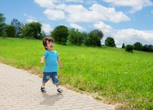 Little boy running in park Stock Image