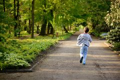 Little boy running in the park. Back view Royalty Free Stock Photo