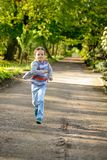 Little boy running in the park. Stock Image