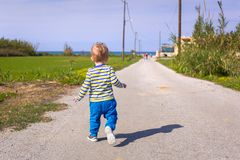 Little boy running on the road on Crete Royalty Free Stock Images